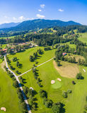 Golf Court Alps. Wonderful Golfcourse in Bavaria near the town of Bad Tölz. In the Background you see the wonderful alps. This shot is made by a drone stock images