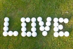 Golf d'amour - amour dans des boules de golf Image stock