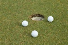 golf de 3 blancos en verde Imágenes de archivo libres de regalías