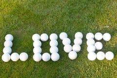 Golf del amor - hecho con las pelotas de golf Fotografía de archivo