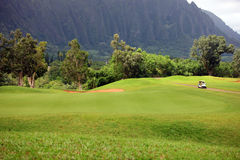 Golf an der Unterseite des Berges Stockbilder