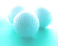 Golf dreaming. Three golf balls and an interesting lighting.......great image for a golf tournament promotion Royalty Free Stock Image