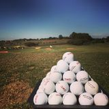 Golf drive range. Golf ball pile Stock Photography