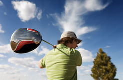 Golf driver. A golfer swinging a large wood (focus on golf club Stock Photos