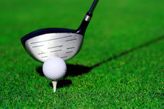Golf driver and ball. Golf drive on the fairway Royalty Free Stock Photo