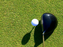 Golf - Driver and Ball. Close-up of ball and driver when preparing for a perfect drive Royalty Free Stock Images