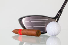 Golf driver and different cigars on a glass desk Royalty Free Stock Photo