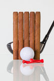 Golf driver and different cigars on a glass desk Royalty Free Stock Images