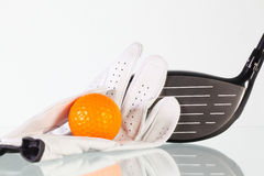Golf driver and white glove on a glass table Stock Images