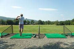 Golf at the Driving Range Royalty Free Stock Photos