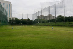 Golf driving range in cloudy day Royalty Free Stock Photo