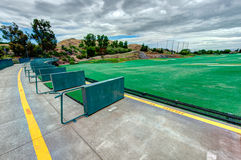 Golf driving range stations above ground Stock Photography