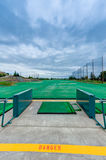 Golf driving range stations above ground Royalty Free Stock Image