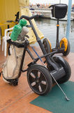 Golf and electrical transportation. An electrical cart used to transport golf club Stock Images