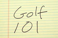 Golf 101 en un cojín legal amarillo imagen de archivo libre de regalías