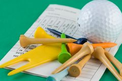 Golf Equipment. Golf ball, tees and scorecard Stock Images