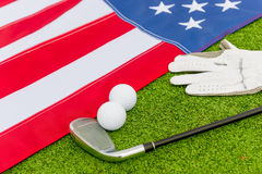 Golf equipment and an American flag Royalty Free Stock Photo