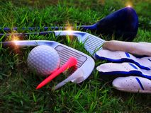 Golf equipment in the field Preparation of equipment for playing golf royalty free stock photo