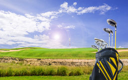 Golf equipment and golf bag on green and hole as background Royalty Free Stock Images