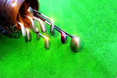 Golf equipment Many pieces in a bag. Golf equipment in the green field royalty free stock image