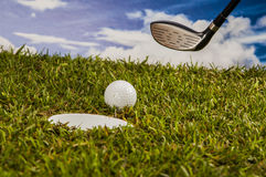 Golf equipment on green grass, golf field Royalty Free Stock Photo