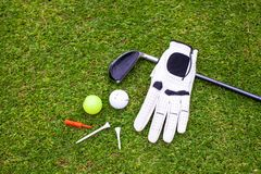 Golf equipment on green grass Royalty Free Stock Photography