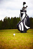 Golf equipment on green and hole Royalty Free Stock Photo