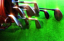 Golf equipment Many pieces in a bag. Golf equipment in the green field stock photos