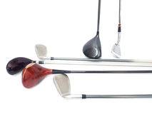 Golf Equipments. Three diferent golf clubs on white background Royalty Free Stock Photo