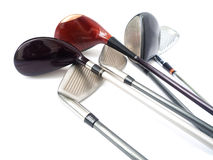 Golf Equipments. Three diferent golf clubs on white background Stock Photography