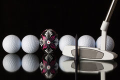 Golf equipments and egg Royalty Free Stock Photos