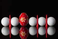 Golf equipments and egg Stock Photography