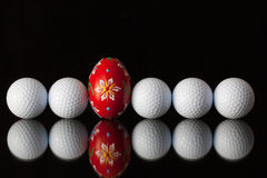 Golf equipments and egg Stock Images
