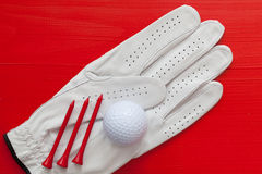 Golf equipments on the  red table Stock Photography