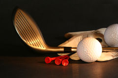 Golf essentials. On black background royalty free stock photo