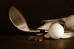 Golf essentials/ B/W. Golf essentials on black background royalty free stock photography