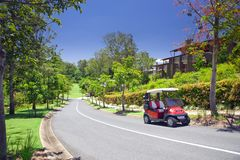 Golf Estate with Buggy in the foreground Stock Images