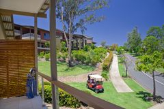 Golf Estate with Buggy in the foreground Royalty Free Stock Photography