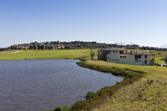 Golf estate with large dam and houses Stock Photography
