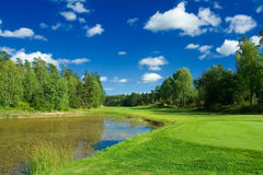 Golf fairway along the pond. Swedish golf landscape on a sunny day in July Stock Image
