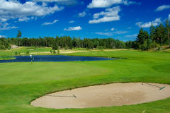 Golf fairway along a pond. Swedish golf landscape on a sunny day in July Royalty Free Stock Photography