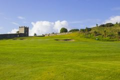 A golf fairway and green in the parkland course in the Roe river valley near Limavady in Northern Ireland. A golf fairway and green with architectural features Stock Photography