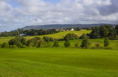 A golf fairway and green in the parkland course in the Roe river valley near Limavady in Northern Ireland Royalty Free Stock Photography