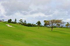 Golf fairway with sandtrap Royalty Free Stock Photography