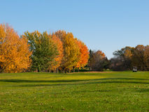 Golf in fall. With cart on the fairway Stock Photo