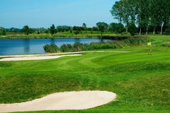 Golf field. With green, lake, sand and hole 17 flag Royalty Free Stock Photography
