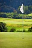 Golf field. Focus on flag Stock Photography