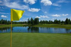 Golf field active leisure flag. Golf club field grass course active leisure flag royalty free stock images