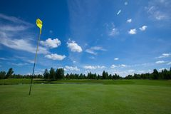 Golf field active leisure flag. Golf club field grass course active leisure stock photography