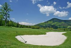 Golf field and beauty landscape. Golf field and beauty surroundings Stock Images